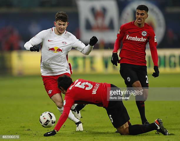 Oliver Burke of RB Leipzig is challenged by Jesus Vallejo of Eintracht Frankfurt during the Bundesliga match between RB Leipzig and Eintracht...