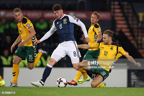 Oliver Burke of Scotland and Ernestas Setkus of Lithuania during the FIFA 2018 World Cup Qualifier between Scotland and Lithuania at Hampden Park on...