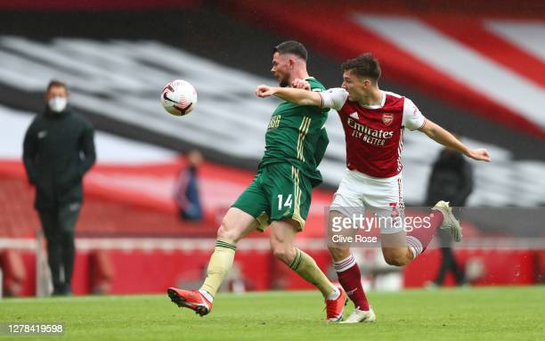 Oliver Burke of Sheffield United battles for possession with Kieran Tierney of Arsenal during the Premier League match between Arsenal and Sheffield...
