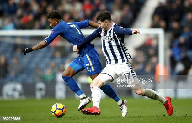 Oliver Burke of West Bromwich Albion attempts to tackle Demarai Gray of Leicester City during the Premier League match between West Bromwich Albion...