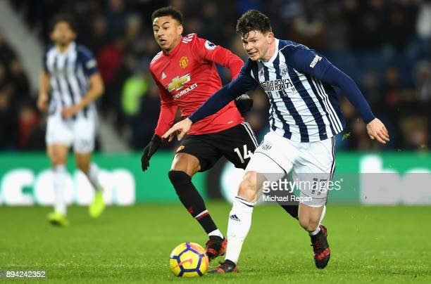 Oliver Burke of West Bromwich Albion runs with the ball away from Jesse Lingard of Manchester United during the Premier League match between West...