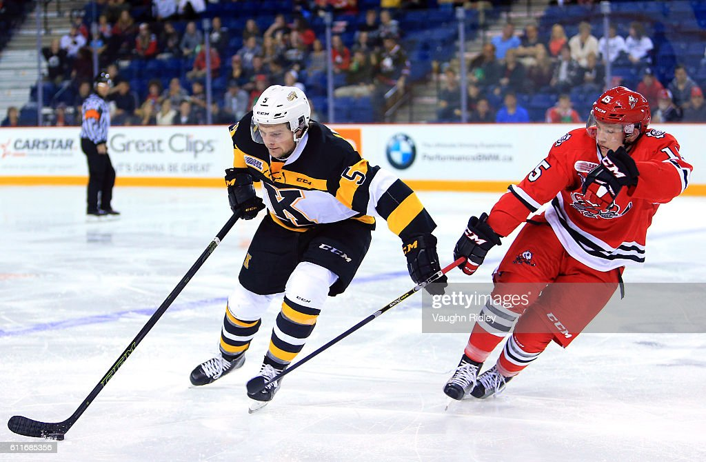 Oliver Castleman #15 of the Niagara IceDogs and Liam Murray #5 of the Kingston Frontenacs battle for the puck during the second period of an OHL game at the Meridian Centre on September 30, 2016 in St Catharines, Ontario, Canada.