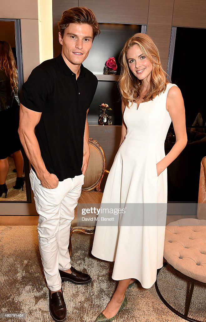 Oliver Cheshire and Donna Air attend Piaget 'Mediterranean Garden' Summer Party on July 15, 2015 in London, England.