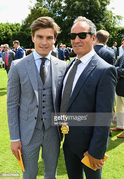 Oliver Cheshire and his father Graham Cheshire attend the Qatar Goodwood Festival 2016 at Goodwood on July 29 2016 in Chichester England