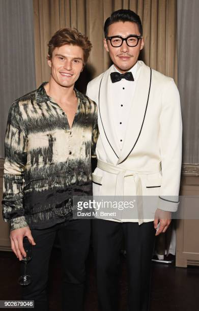 Oliver Cheshire and Hu Bing attend the GQ London Fashion Week Men's 2018 closing dinner hosted by Dylan Jones and Rita Ora at Berners Tavern on...