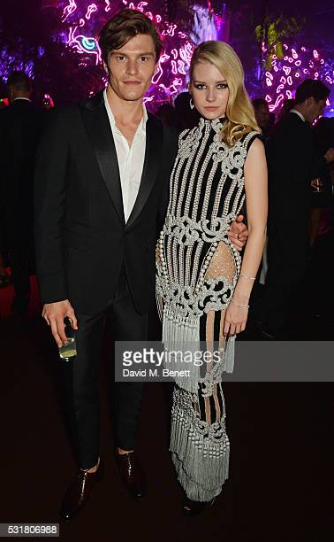 Oliver Cheshire and Lottie Moss attend the Chopard Wild Party during the 69th Annual Cannes Film Festival at Port Canto on May 16 2016 in Cannes