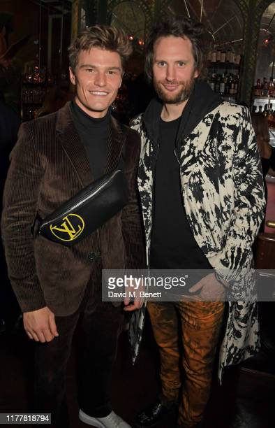 Oliver Cheshire and Marc JacquesBurton attend an after party celebrating the reopening of the Louis Vuitton New Bond Street Maison at Annabel's on...