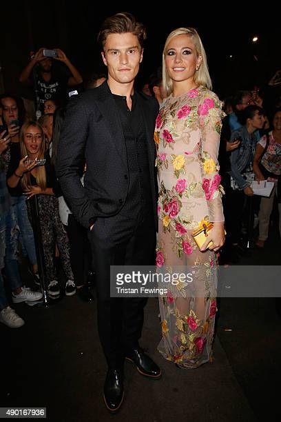 Oliver Cheshire and Pixie Lott arrive at amfAR Milano 2015 at La Permanente on September 26 2015 in Milan Italy