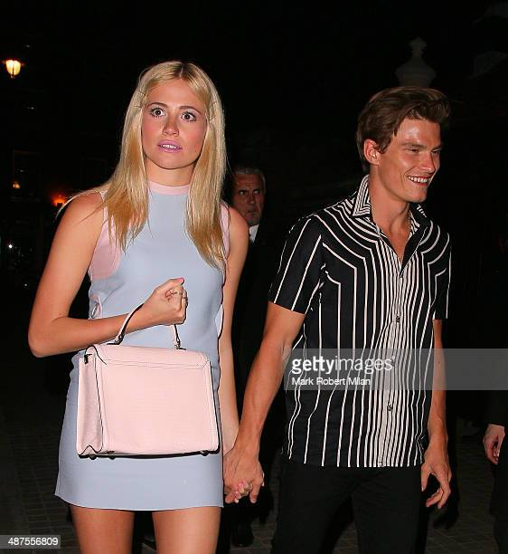 Oliver Cheshire and Pixie Lott at the Chiltern Firehouse for a Prada event on April 30 2014 in London England