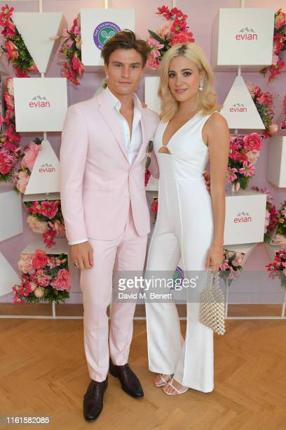 Oliver Cheshire and Pixie Lott at the evian Live Young suite at The Championships Wimbledon 2019 on July 12 2019 in London England