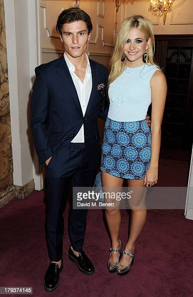 Oliver Cheshire and Pixie Lott attend as Sir Elton John is awarded the first annual 'BRITS Icon' award at the London Palladium on September 2 2013 in...
