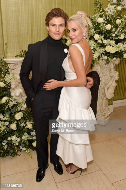 Oliver Cheshire and Pixie Lott attend the British Vogue and Tiffany Co Fashion and Film Party at Annabel's on February 2 2020 in London England