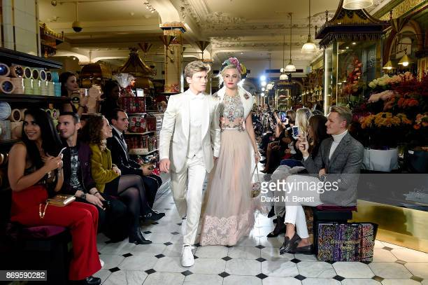 Oliver Cheshire and Pixie Lott attend the Dolce Gabbana Italian Christmas at Harrods on November 2 2017 in London England