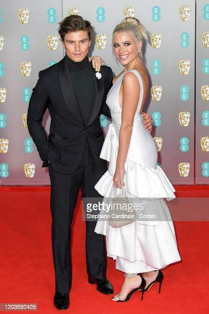 Oliver Cheshire and Pixie Lott attend the EE British Academy Film Awards 2020 at Royal Albert Hall on February 02 2020 in London England