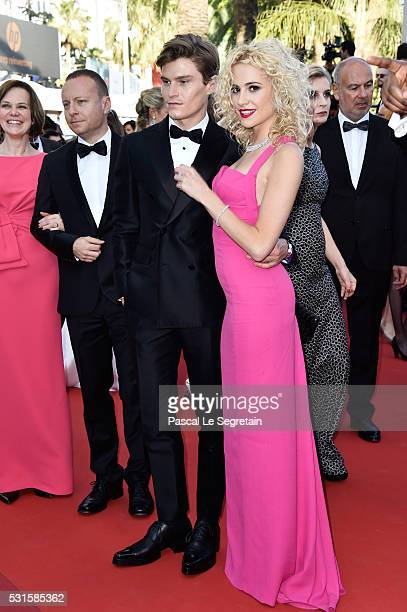 """Oliver Cheshire and Pixie Lott attend the """"From The Land Of The Moon """" premiere during the 69th annual Cannes Film Festival at the Palais des..."""