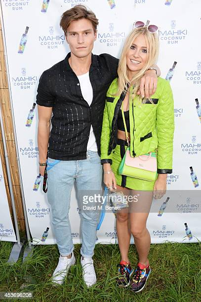 Oliver Cheshire and Pixie Lott attend the Mahiki Rum Bar for the launch of the Mahiki Rum Family backstage during day 1 of the V Festival 2014 at...