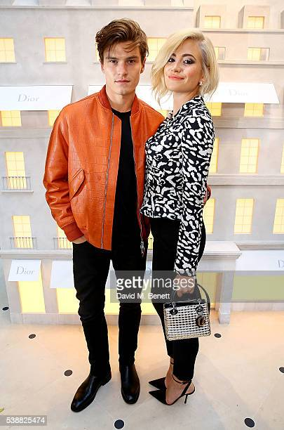 Oliver Cheshire and Pixie Lott attend the opening of the House Of Dior on New Bond Street on June 8 2016 in London England