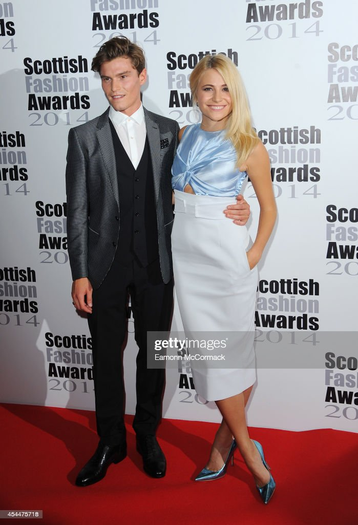 Oliver Cheshire and Pixie Lott attend The Scottish Fashion Awards on September 1, 2014 in London, England.