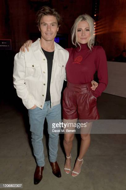 Oliver Cheshire and Pixie Lott attend the TOMMYNOW London Spring 2020 at Tate Modern on February 16, 2020 in London, England.