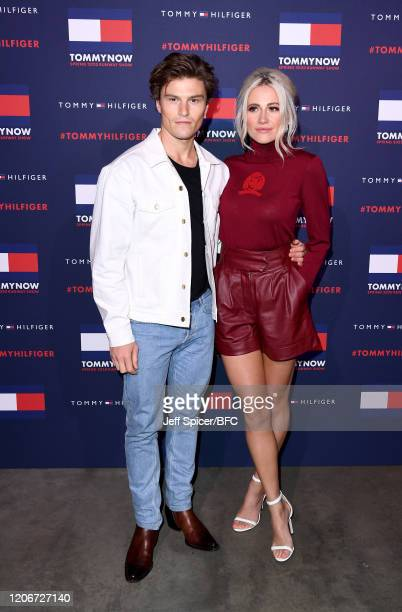 Oliver Cheshire and Pixie Lott attend the TommyNow show during London Fashion Week February 2020 at the Tate Modern on February 16, 2020 in London,...