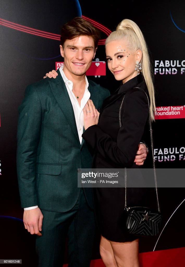Oliver Cheshire (left) and Pixie Lott attending the Naked Heart Foundation Fabulous Fun dFair held at The Roundhouse in Chalk Farm, London.