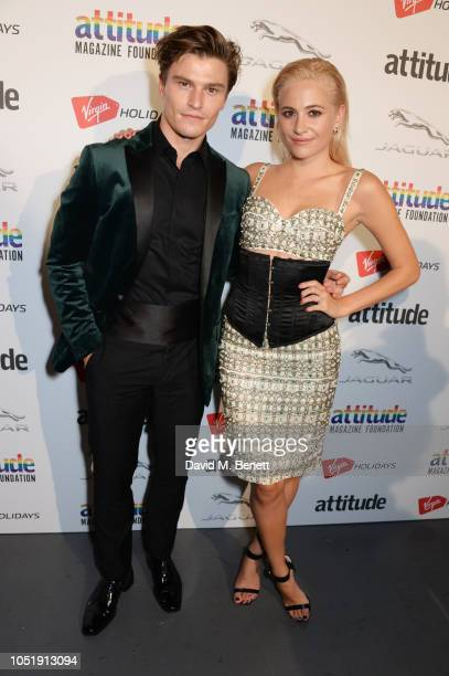 Oliver Cheshire and Pixie Lott pose in the winners room at The Virgin Holidays Attitude Awards at The Roundhouse on October 11 2018 in London England