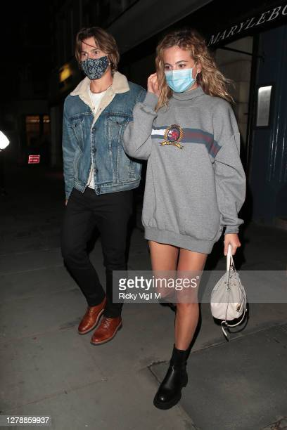 Oliver Cheshire and Pixie Lott seen on a night out leaving Taka Marylebone on October 06, 2020 in London, England.