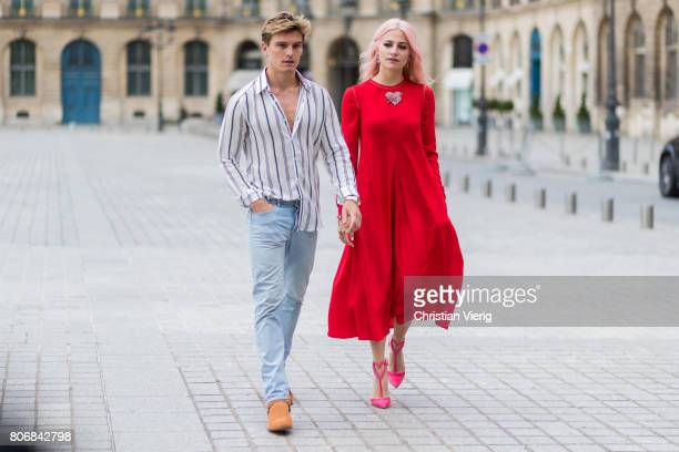 Oliver Cheshire and Pixie Lott wearing a red dress outside Schiaparelli during Paris Fashion Week Haute Couture Fall/Winter 20172018 Day Two on July...
