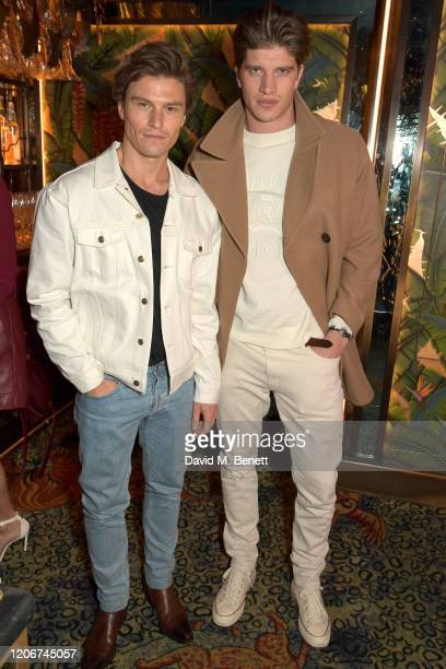 Oliver Cheshire and Toby HuntingtonWhiteley attend the TOMMYNOW after party at Annabels on February 16 2020 in London England