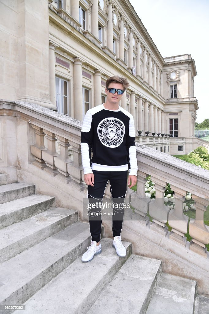 Oliver Cheshire attends the Balmain Menswear Spring/Summer 2019 show as part of Paris Fashion Week on June 24, 2018 in Paris, France.