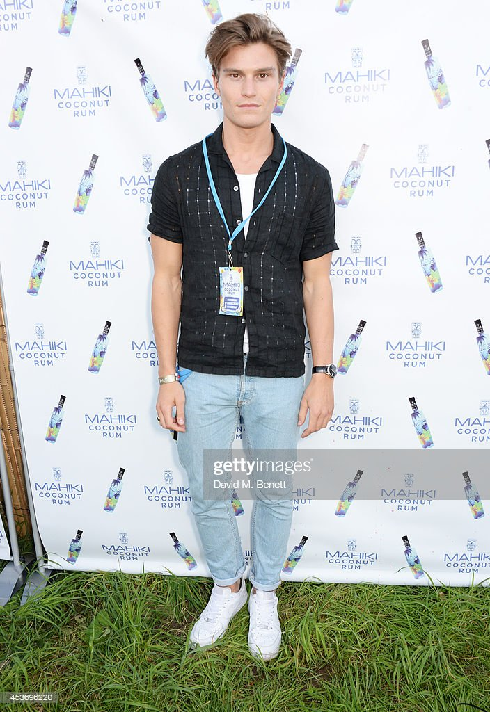 Oliver Cheshire attends the Mahiki Rum Bar for the launch of the Mahiki Rum Family backstage during day 1 of the V Festival 2014 at Hylands Park on August 16, 2014 in Chelmsford, England.