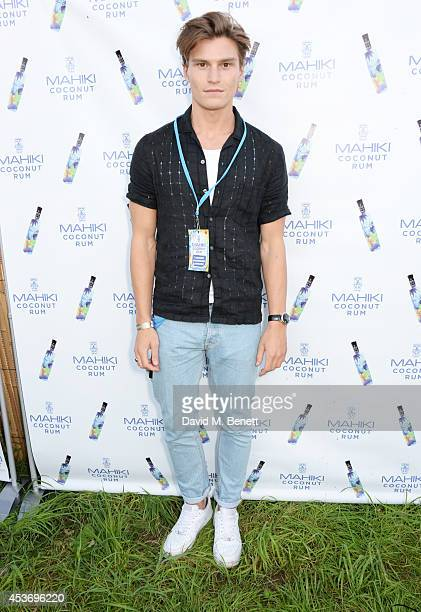 Oliver Cheshire attends the Mahiki Rum Bar for the launch of the Mahiki Rum Family backstage during day 1 of the V Festival 2014 at Hylands Park on...