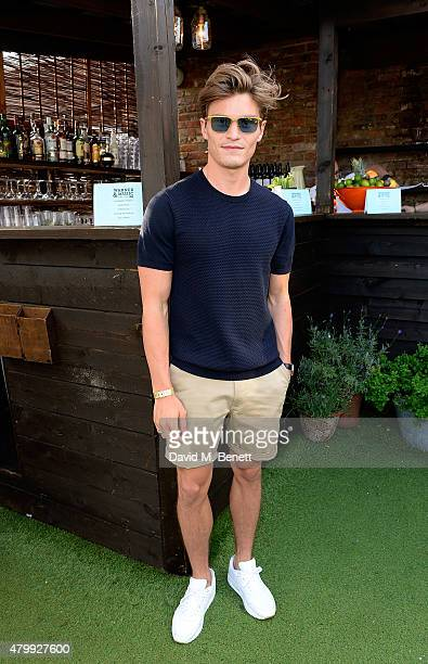 Oliver Cheshire attends the Warner Summer Party in association with British GQ at Shoreditch House on July 8 2015 in London England