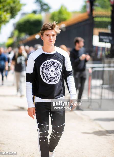 Oliver Cheshire is seen outside Balmain on day six of Paris Fashion Week Menswear SS19 on June 24 2018 in Paris France