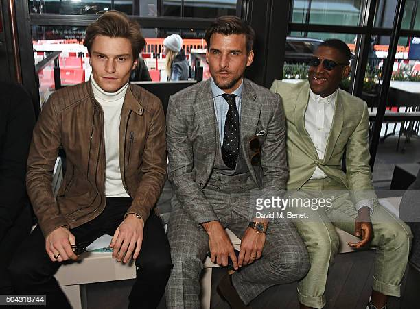 Oliver Cheshire, Johannes Huebl and Labrinth attend the Richard James show front row during The London Collections Men AW16 at Sartoria on January...