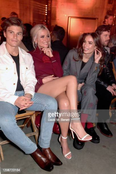 Oliver Cheshire, Pixie Lott and Hana Cross attend the TOMMYNOW London Spring 2020 at Tate Modern on February 16, 2020 in London, England.