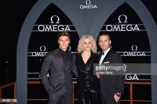 Oliver Cheshire Pixie Lott and Raynald Aeschlimann attend the OMEGA Aqua Terra at Palazzo Pisani Moretta on October 28 2017 in Venice Italy