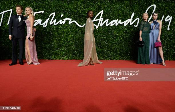 Oliver Cheshire Pixie Lott Dina AsherSmith guest and Maxim Magnus arrive at The Fashion Awards 2019 held at Royal Albert Hall on December 02 2019 in...