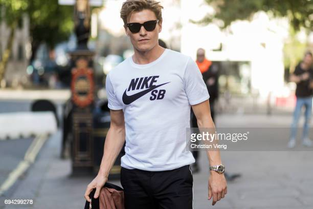 Oliver Cheshire wearing a white Nike tshirt during the London Fashion Week Men's June 2017 collections on June 9 2017 in London England