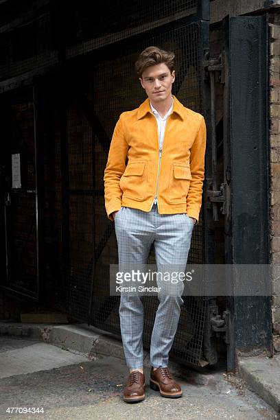 Oliver Cheshire wears a Hardy Amies jacket shirt and trousers Grenson shoes and chain from Leather Lane market London on day 2 of London Collections...