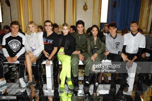 Oliver Cheshire Xenia AdontsCarlo Sestini Caroline Daur Marc Forne Aleali May Jessey Stevens and Guido Milani attend the Balmain Menswear...