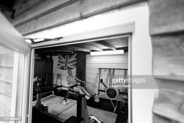 Oliver Cook of Great Britain trains in his garage at home on a rowing machine 'Ergo' on April 01 2020 in Windsor England The coronavirus and the...