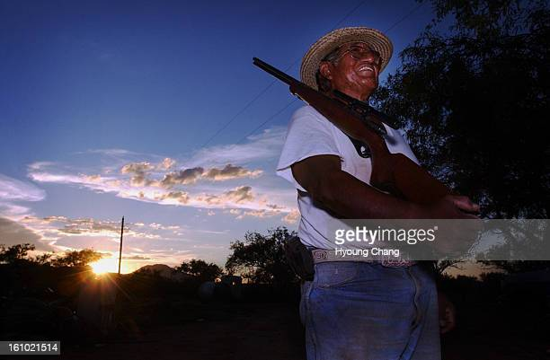 SELLS AZ AUGUST 29 2003 Oliver <cq> Smith <cq> rancher of Tohono Indian Nation Sells AZ lives a mile away from Mexican Border Smith keeps 3 rifles...