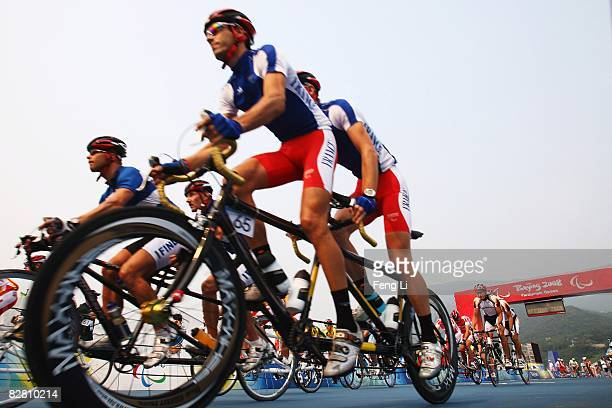 Oliver Donval and pilot John Saccomondi of France complete in the Road Cycling Men's Road Race event at the Triathlon Venue during day eight of the...