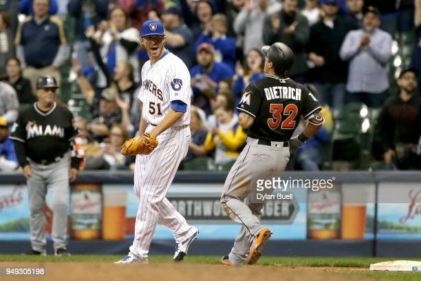 Oliver Drake of the Milwaukee Brewers celebrates after forcing out Derek Dietrich of the Miami Marlins to beat the Miami Marlins 80 at Miller Park on...