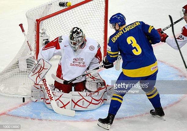 Oliver Ekman Larsson of Sweden battles for the puck with Patrick Galbrath of Denmark during the IIHF World Championship quarter final match between...