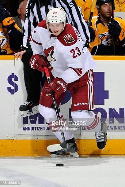 Oliver EkmanLarsson 23 of the Phoenix Coyotes skates against the Nashville Predators at Bridgestone Arena on April 10 2014 in Nashville Tennessee