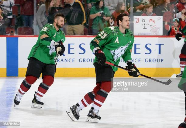 Oliver EkmanLarsson and Brad Richardson of the Arizona Coyotes wear special green warm up jerseys in recognition of St Patrick's Day prior to a game...