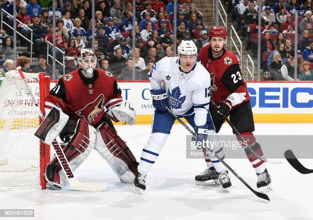 Oliver EkmanLarsson and Scott Wedgewood of the Arizona Coyotes looks for the puck as Patrick Marleau of the Toronto Maple Leafs battles for position...