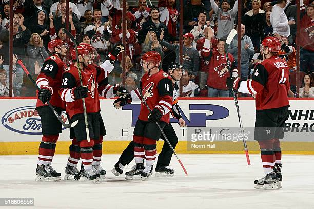 Oliver EkmanLarsson Brad Richards Max Domi and Zbynek Michalek celebrate a third period goal by teammate Shane Doan against the Washington Capitals...